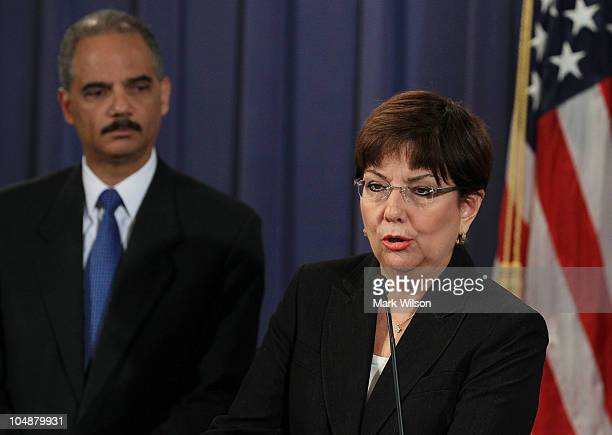 S Attorney for the District of Puerto Rico Rosa Emilia RodriguezVelez speaks while Attorney General Eric Holder listens during a news conference at...