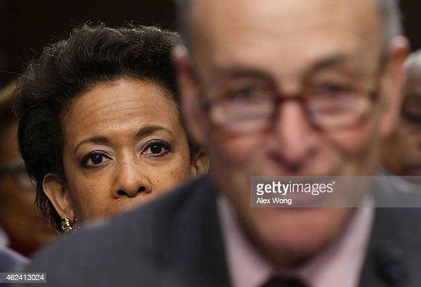 S Attorney for the Eastern District of New York Loretta Lynch listens as US Sen Charles Schumer testifies for her during a confirmation hearing...