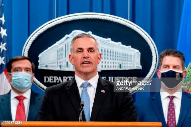 Attorney for the Western District of Pennsylvania Scott Brady, center, accompanied by Assistant Attorney General for the National Security Division...