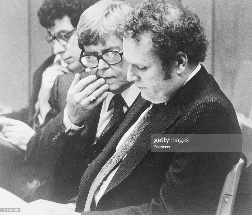 Attorney Gene Reeves (C) confers with client Larry Flynt (R) during court proceedings, March 6th, prior to the noon recess when Flynt and Reeves were shot by a gunman. Flynt was reported in critical condition undergoing surgery for a wound in the abdomen. Reeves was less seriously injured.