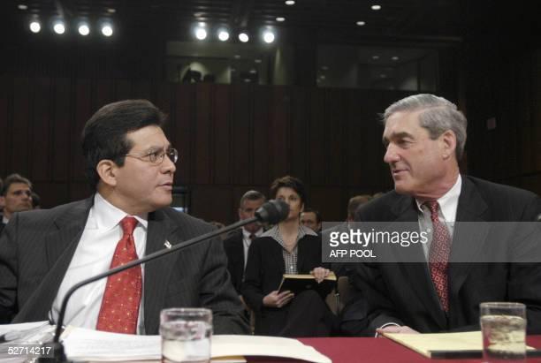 Attorney General Alberto Gonzales testifies with FBI Director Robert Mueller III in support of the Patriot Act before the Senate Intelligence...