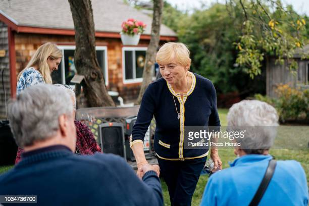 Attorney General and Democratic Gubernatorial candidate Janet Mills greets supporters during a campaign stop at State Representative Lois Reckitt's...