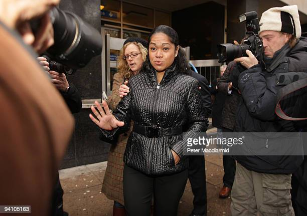 Attorney General Baroness Scotland's former cleaner Loloahi Tapu gestures to photographers as she leaves Westminster Magistrates Court on December 7,...