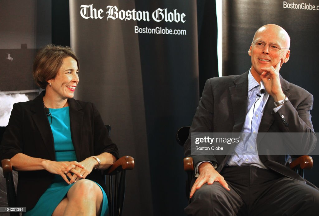 Attorney General candidates Maura Healey and Warren Tolman appear in a debate at The Boston Globe on August 26, 2014.
