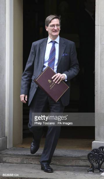 Attorney general Dominic Grieve leaves 10 Downing Sreet in central London after a cabinet meeting