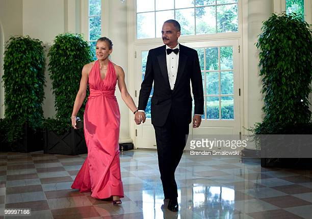 Attorney General Eric H Holder Jr and Dr Sharon Malone arrive at the White House for a state dinner May 19 2010 in Washington DC President Barack...