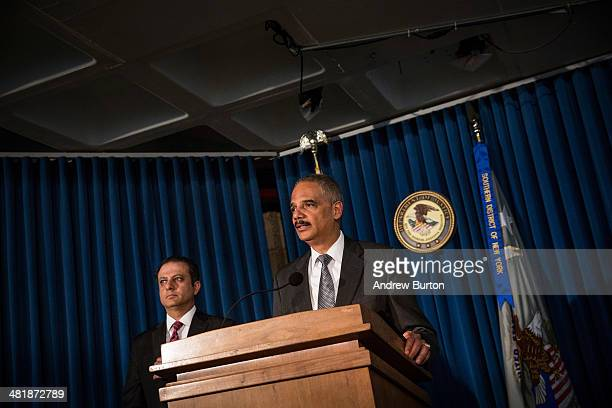 S Attorney General Eric Holder and US Attorney for the South District of New York Preet Bharara speak at a press conference at the US Attorney's...
