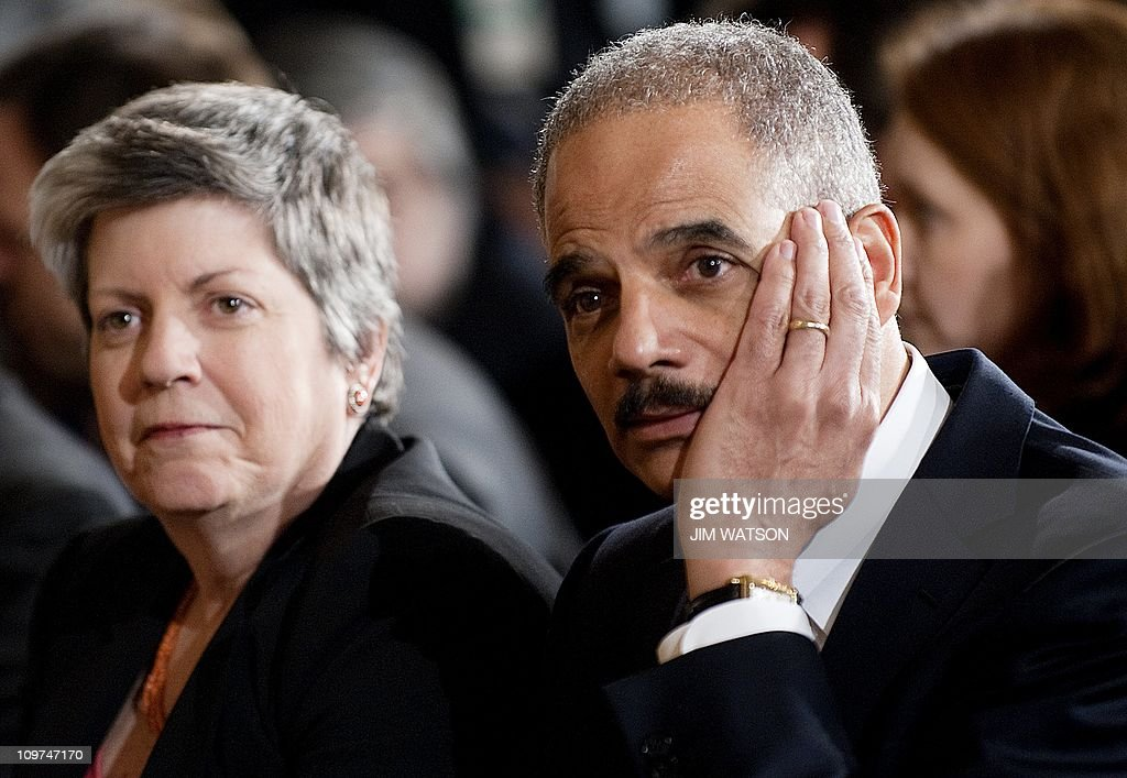US Attorney General Eric Holder (R) and : News Photo