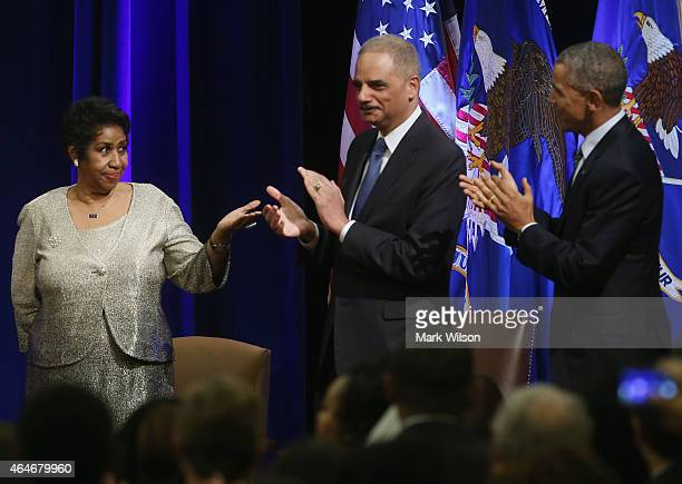 S Attorney General Eric Holder and US President Barack Obama applaud after singer Aretha Franklin finished singing America The Beautiful during a...