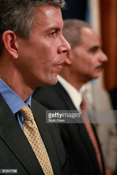 S Attorney General Eric Holder and US Secretary of Education Arne Duncan listen as Chicago Mayor Richard M Daley speaks during a press conference at...