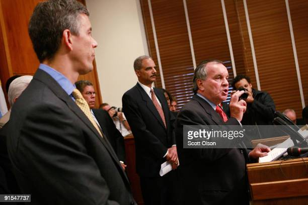 S Attorney General Eric Holder and US Secretary of Education Arne Duncan join Chicago Mayor Richard M Daley for a press conference at City Hall to...