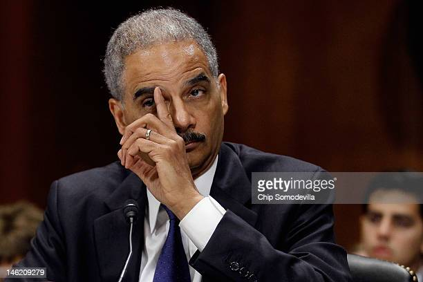 S Attorney General Eric Holder answers questions while testifying before the Senate Judiciary Committee on Capitol Hill June 12 2012 in Washington DC...