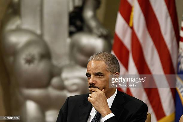S Attorney General Eric Holder attends the Dr Martin Luther King Jr Commemorative Program at the Department of Justice January 11 2011 in Washington...