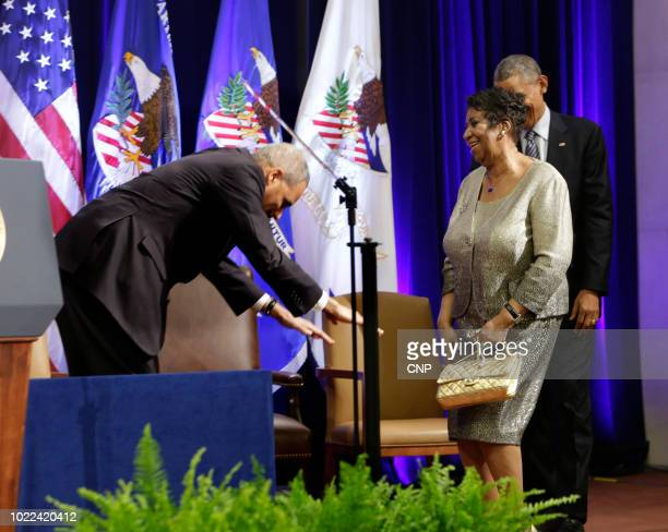 US Attorney General Eric Holder 'bows' to American singer Aretha Franklin at the Robert F Kennedy Department of Justice Building Washington DC...