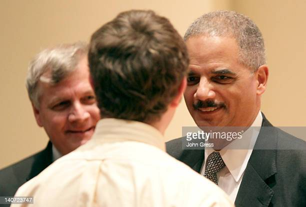 S Attorney General Eric Holder greets law students before speaking at Northwestern Law School March 5 2012 in Chicago Illinois Holder was expected to...