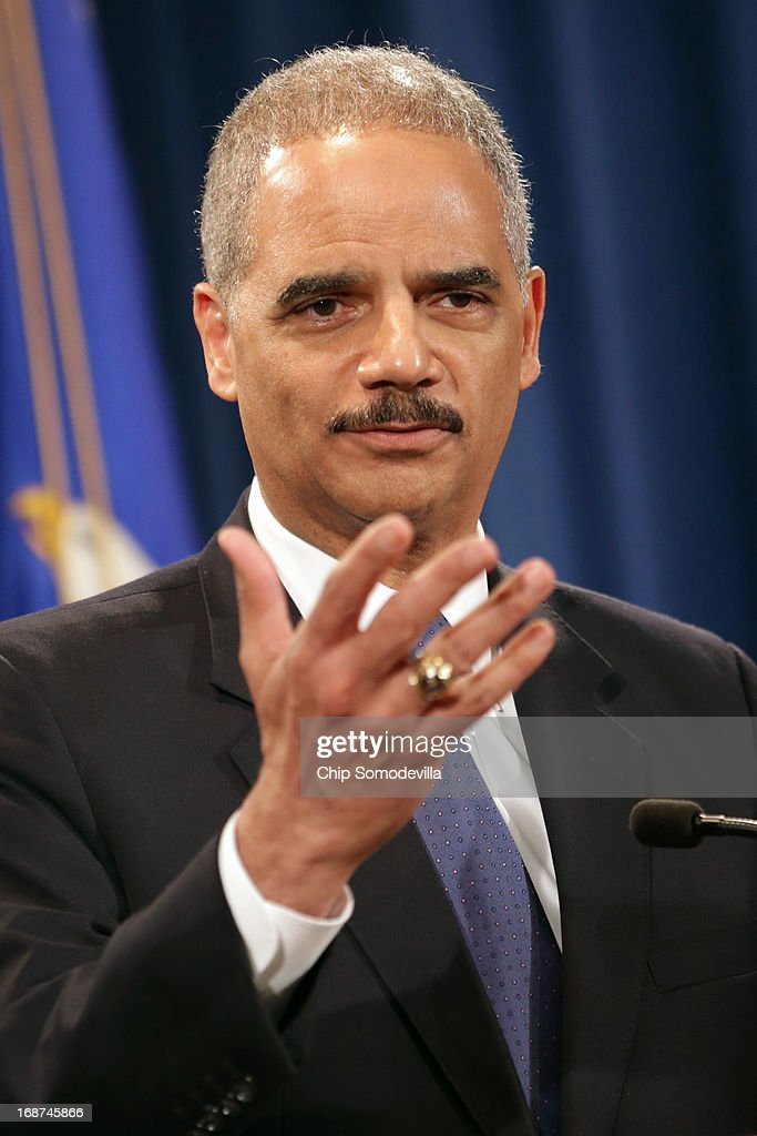 U.S. Attorney General Eric Holder holds a Medicare fraud news conference at which he said he recused himself last year from a national security leak probe in which prosecutors obtained the phone records of Associated Press journalists at the Justice Department May 14, 2013 in Washington, DC. Holder faced a large number of questions about his department's investigation targeting phone records and data from the Associated Press.