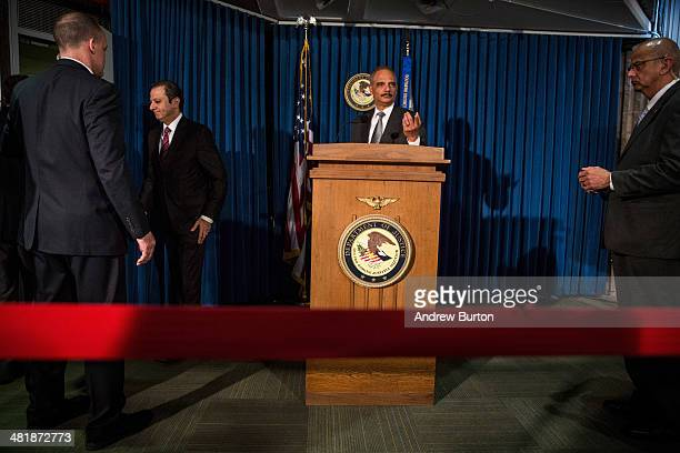 S Attorney General Eric Holder is asked questions by reporters as he leaves a press conference at the US Attorney's Office for the Souther District...