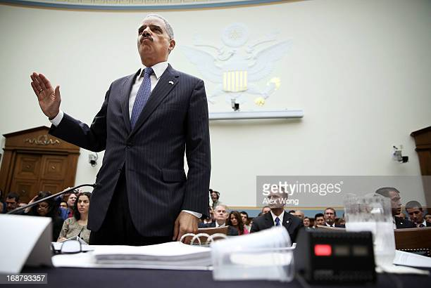 S Attorney General Eric Holder is sworn in during a hearing before the House Judiciary Committee on oversight of the US Department of Justice May 15...