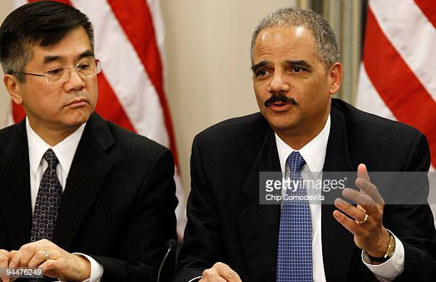 Attorney General Eric Holder makes brief remarks during a roundtable discussion enforcing laws against the piracy of intellectual property with...