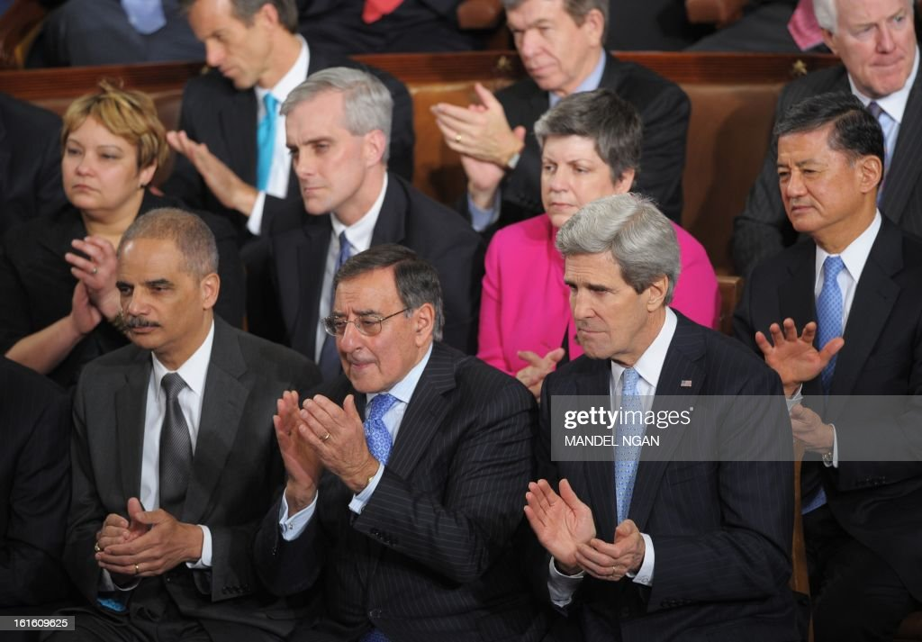 Attorney General Eric Holder, outgoing Defense Secretary Leon Panetta, Secretary of State John Kerry, (second row) EPA Administrator Lisa Jackson, White House Chief of Staff Denis McDonough, Homeland Security Secretary Janet Napolitano and Veterans Affairs Secretary Eric Shinseki applaud as US President Barack Obama delivers his State of the Union address before a joint session of Congress on February 12, 2013 at the US Capitol in Washington, DC. AFP PHOTO/Mandel NGAN