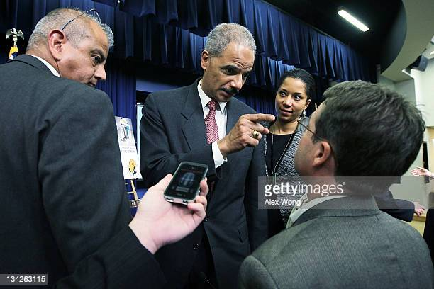 Attorney General Eric Holder ) points his finger as he talks to Daily Caller reporter Neil Munro at the end of an event to launch a campaign to...