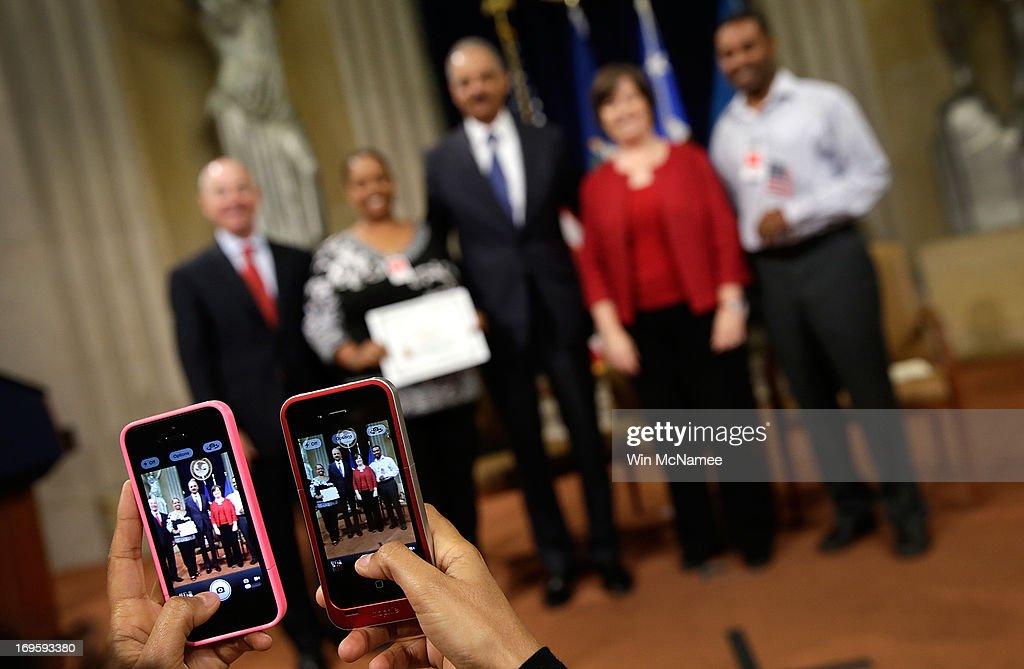 Holder Speaks At Naturalization Ceremony At Justice Department