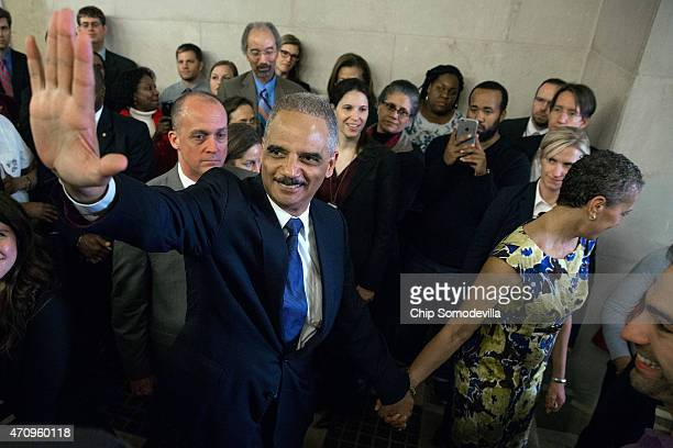 S Attorney General Eric Holder says goodbye to Justice Department employees as he leaves the Robert F Kennedy building with his wife April 24 2015 in...