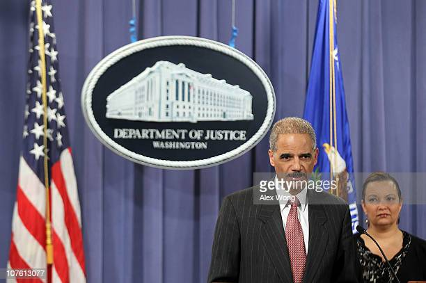 S Attorney General Eric Holder speaks as Environmental Protection Agency Administrator Lisa Jackson listens during a news conference to announce an...