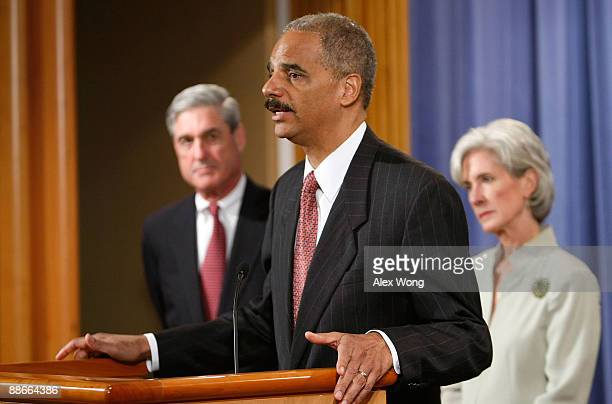 S Attorney General Eric Holder speaks as Health and Human Services Secretary Kathleen Sebelius and FBI Director Robert Mueller listen during a news...