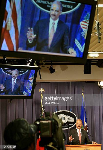 Attorney General Eric Holder speaks during a press conference announcing an antitrust lawsuit against major credit card companies at the Justice...