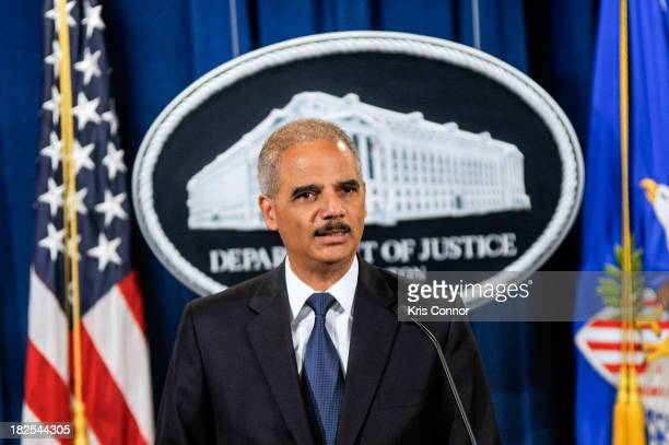 S Attorney General Eric Holder speaks during a press conference announcing Department of Justice plans to sue North Carolina over Voter ID...