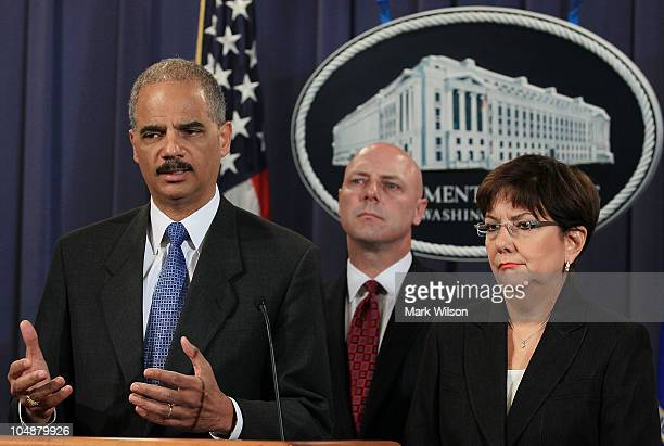 Attorney General Eric Holder speaks while FBI Executive Assistant Director Shawn Henry and US Attorney for the District of Puerto Rico Rosa Emilia...