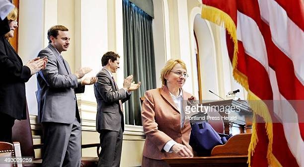 Attorney General Janet Mills is applauded by Senate President Justin Alfond second from right Speaker of the House Mark Eves and Supreme Court Chief...