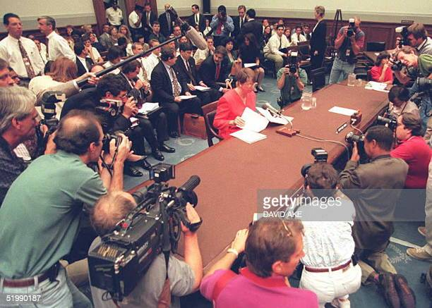 Attorney General Janet Reno is surrounded by photographers before testifying to a congressional subcommittee in Washington on the final day of two...