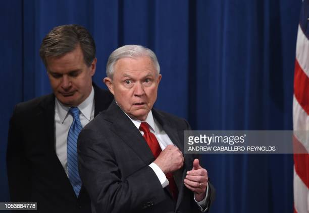 Attorney General Jeff Sessions and FBI Director Chris Wray arrive for a press conference regarding the arrest of bombing suspect Cesar Sayoc in...