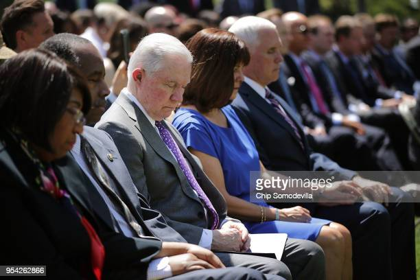 S Attorney General Jeff Sessions and fellow members of President Donald Trump's cabinet bow their heads in prayer during an event to mark the...