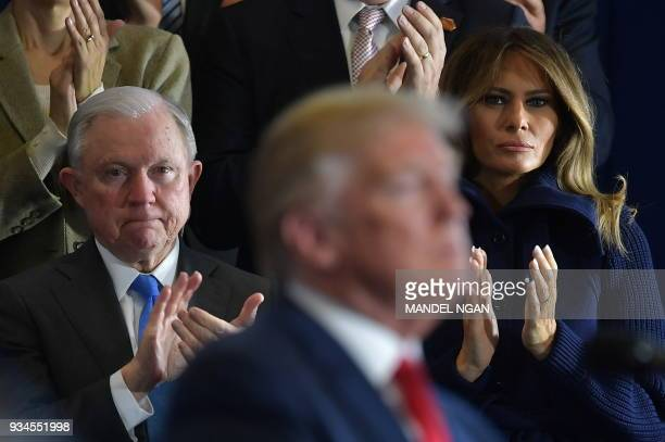Attorney General Jeff Sessions and First Lady Melania Trump applaud as US President Donald Trump speaks about combating the opioid crisis at...