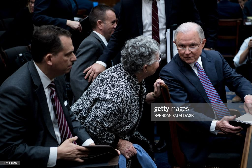 US Attorney General Jeff Sessions and his wife Mary Blackshear Sessions talk during a break in a hearing of the House Judiciary Committee on Capitol Hill November 14, 2017 in Washington, DC. Sessions vowed Tuesday to decide quickly on whether to appoint a special prosecutor to investigate Hillary Clinton's alleged mishandling of classified materials. / AFP PHOTO / Brendan Smialowski