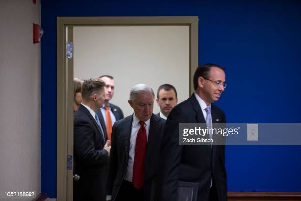 S Attorney General Jeff Sessions and US Deputy Attorney General Rod Rosenstein arrive before speaking during a news conference on efforts to reduce...