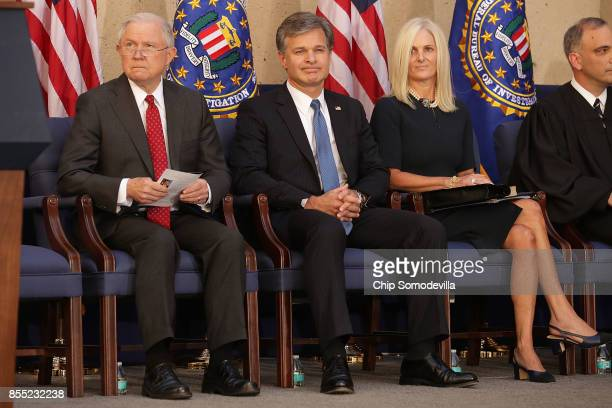 US Attorney General Jeff Sessions Federal Bureau of Investigation Director Christopher Wray and his wife Helen Wray attend Wray's installation...
