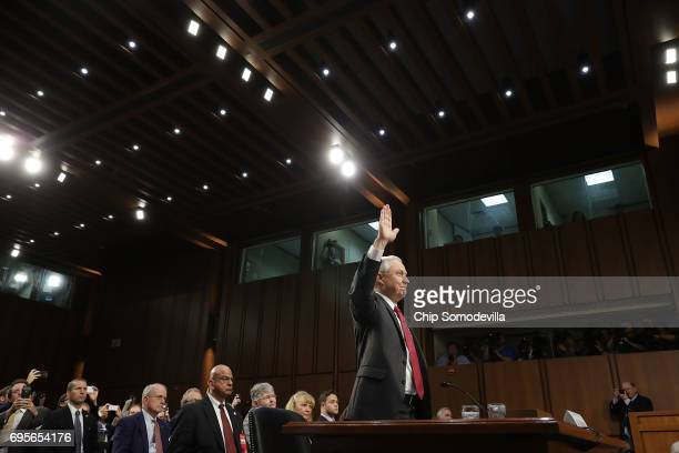Attorney General Jeff Sessions is sworn-in before testifying before the Senate Intelligence Committee about Russian interference in the 2016...