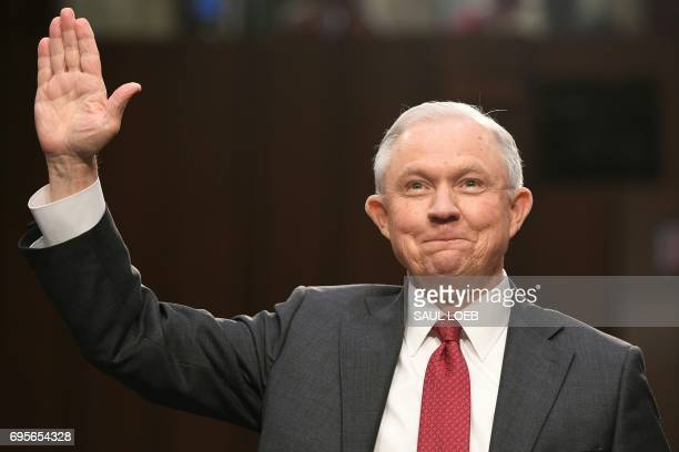 Attorney General Jeff Sessions is swornin before testifying during a US Senate Select Committee on Intelligence hearing on Capitol Hill in Washington...