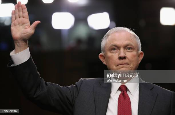 Attorney General Jeff Sessions is swornin prior to testifying before the Senate Intelligence Committee on June 13 2017 in Washington DC The nation's...