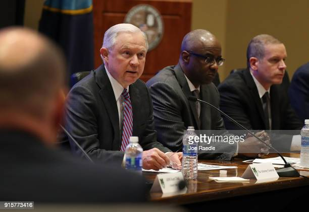 S Attorney General Jeff Sessions joins with Anthony Williams Drug Enforcement Administration associate administrator during the opening remarks at...
