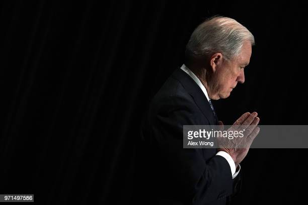S Attorney General Jeff Sessions listens as he is introduced during the Justice Department's Executive Officer for Immigration Review Annual Legal...