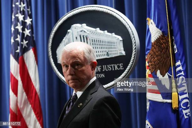 S Attorney General Jeff Sessions listens during a news conference at the Justice Department November 29 2017 in Washington DC Sessions announced the...