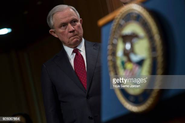 Attorney General Jeff Sessions listens during a press conference at the Department of Justice in Washington DC on February 27 2018 Sessions...