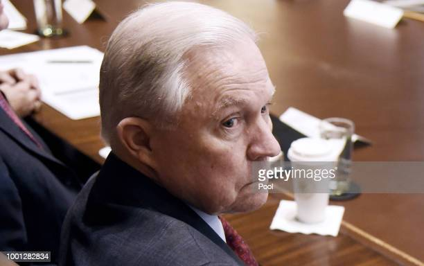 Attorney General Jeff Sessions looks on during a cabinet meeting with US President Donald Trump in the Cabinet Room of the White House July 18 2018...