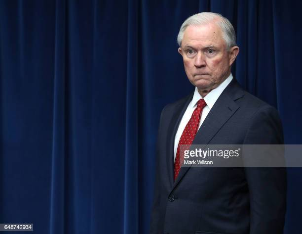 Attorney General Jeff Sessions prepares to give remarks related to a reconstituted travel ban during a news conference at the US Customs and Borders...