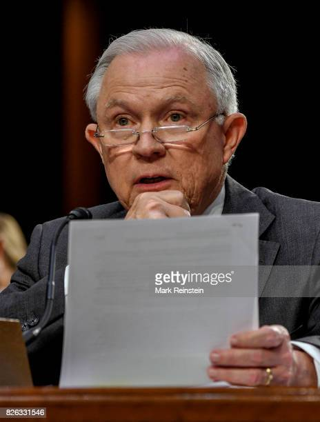 Attorney General Jeff Sessions reads from a document as testifies before the Senate Intelligence Committee, Washington DC, June 13, 2017.